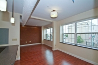 All units have hardwood floors and decorative exposed brick wall accents